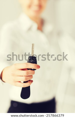business, banking, vehicle, rental, automotive concept - woman hand holding car key - stock photo
