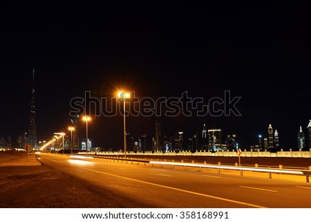 business bay and burj Khalifa landscape at the night, Dubai, United Arab Emirates - stock photo
