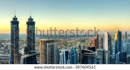 Business bay in Dubai with modern skyscrapers. Beautiful urban landscape at sunset.
