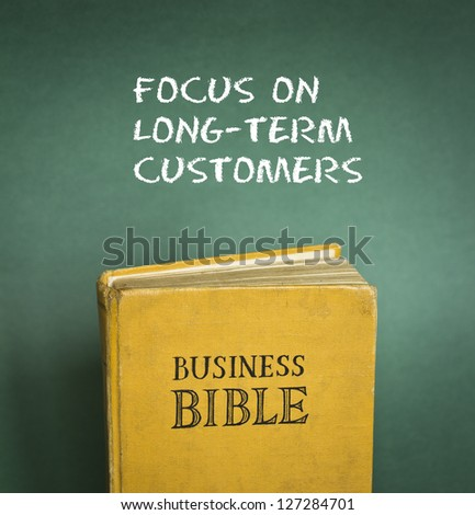 Business Bible commandment - Focus on long-term customers - stock photo