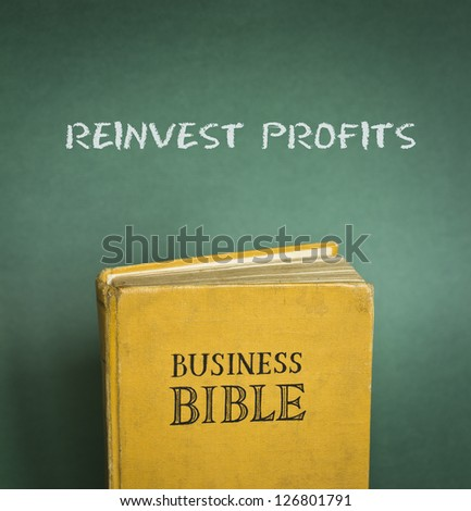 Business Bible commandment - Reinvest profits - stock photo