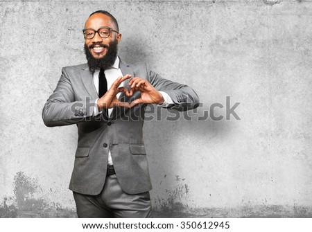 business black man doing a heart sign - stock photo