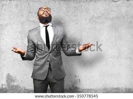 business black man praying - stock photo