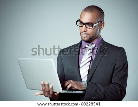 business black man whit laptop - stock photo