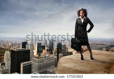 business black woman on the top of the building - stock photo