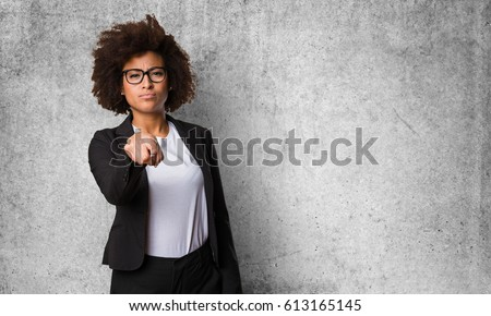 business black woman pointing front
