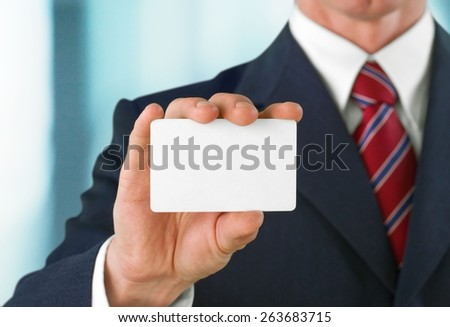 Business. Blank business card in a hand - stock photo