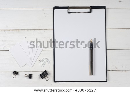 Business blank, notepad and pen at office desk table top view. Corporate stationery branding mock-up.  Copy space for text. - stock photo