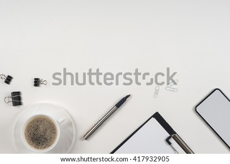 Business blank, notepad,  coffee cup and pen at office desk table top view. Corporate stationery branding mock-up.  Copy space for text. - stock photo