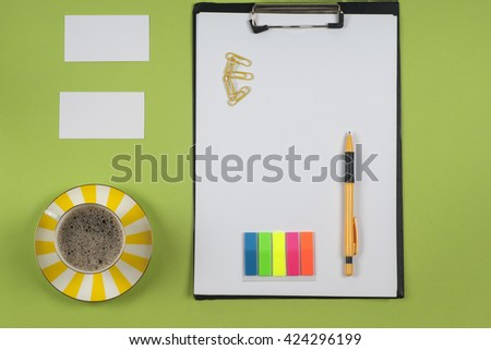 Business blank, notepad,  coffee cup and pen at office desk table top view. Corporate stationery branding mock-up - stock photo
