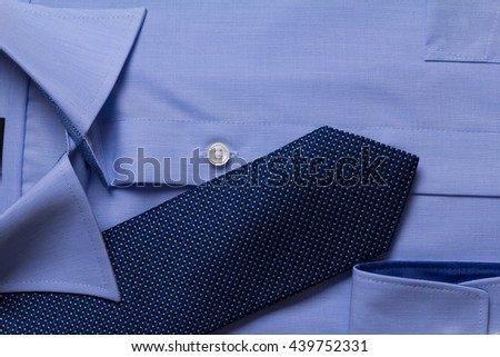 business blue shirt and necktie close up photo. Image has copy space - stock photo