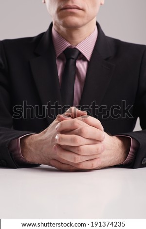 Business Body language. Businessman's hands at the white meeting table. - stock photo