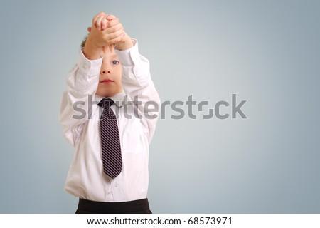 business boy isolated on blue background - stock photo