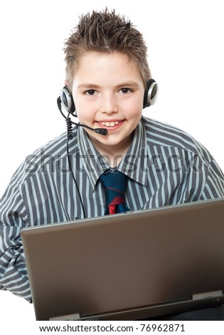 Business boy smiling with headphones and laptop - stock photo
