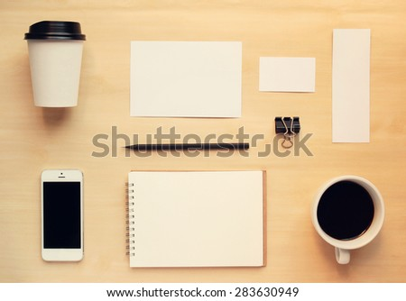 Business branding identity mock up set in workspace with retro filter effect - stock photo