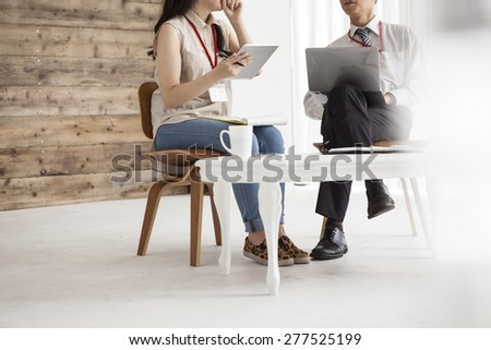 Business briefing on laptop in office - stock photo