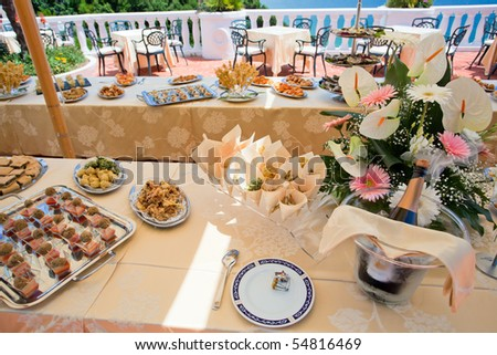 Business buffet on a wonderful terrace overlooking the sea - stock photo