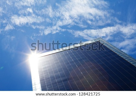 business building and blue sky with sunbeams - stock photo