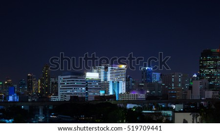 Business Building Bangkok city area at night life, panorama view shot, technology theme background