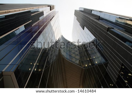 Business building, blue glass, white sky background - stock photo