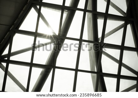 Business building interior, sunburst over building roof,structure pattern - stock photo