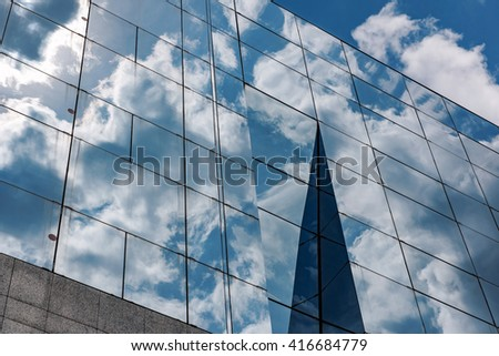 Business building with cloud reflections.