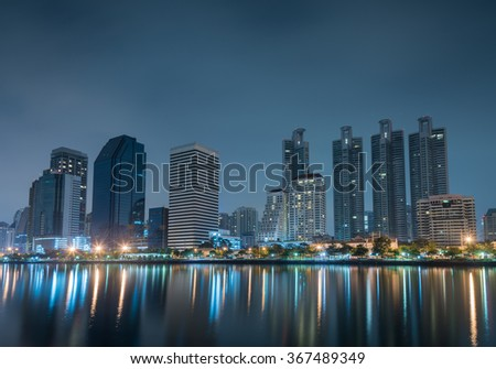 Business buildings in Bangkok at Benjakiti park night Scene of Thailand