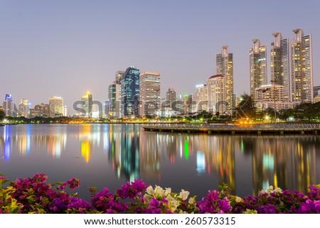 Business buildings in Bangkok seen from Benjakiti park. - stock photo