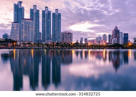 Business buildings riverside in Bangkok seen from Benjakiti park, scene in the morning, Thailand - stock photo
