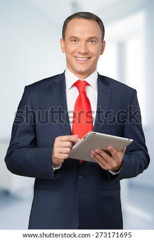 Business. Business man working on digital tablet - stock photo