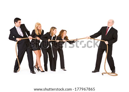 Business: Business Team And Manager Playing Tug Of War - stock photo