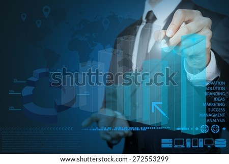 Business. Businessman hand drawing virtual chart business on touch screen computer - stock photo