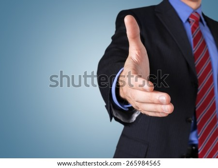 Business. Businessman offering for handshake - stock photo