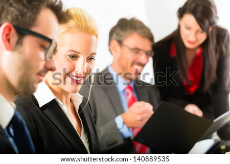 Business - businesspeople have a meeting or workshop with presentation in office, they negotiate or sign a contract - stock photo