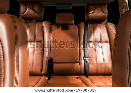 Business car interior. Rear leather seats. - stock photo