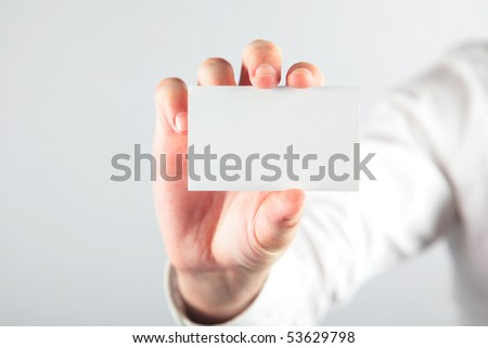 Business card blank in a hand on the white