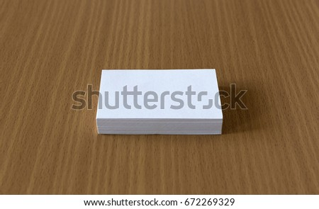 Business card blank on wooden table.