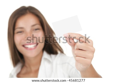 Business card. Casual young and attractive businesswoman showing her blank white business card / empty sign. Mixed race chinese / caucasian model isolated on seamless white background. - stock photo
