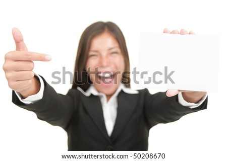 Business card. Excited woman pointing at business card / blank empty sign. Isolated on white background, focus on hand and card. - stock photo