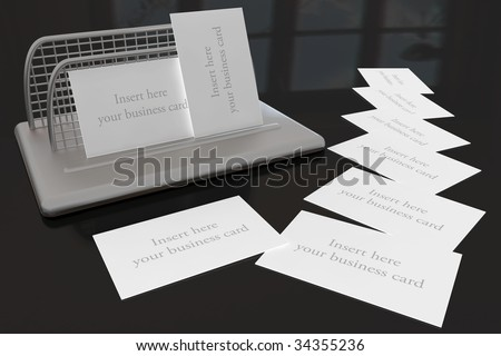 Business Card Holder on Black Desk with space for your own business cards - stock photo