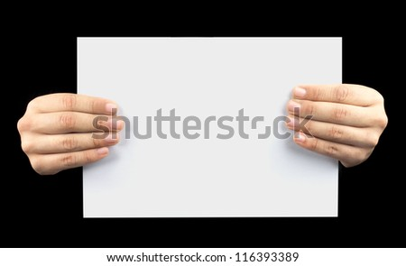 business card in a hand on the black - stock photo