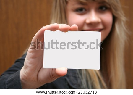 business card in hands at a girl