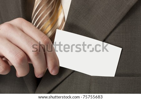 Business card in his hand - stock photo
