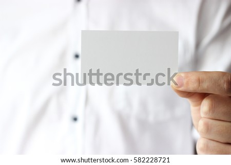 Business card in male hands, business concept.