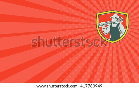 Business card showing illustration of a mechanic holding spanner on shoulder looking to the side set inside shield crest on isolated background done in retro style.  - stock photo