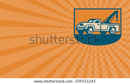 Business card showing Retro illustration of a vintage tow wrecker pickup truck viewed from side. - stock photo