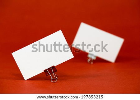 Business card template mockup for branding identity and hipster logo prints. Isolated on red paper background. - stock photo