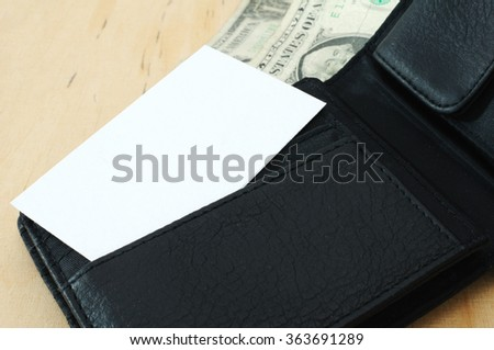 Business card with blank space in wallet with dollars   - stock photo
