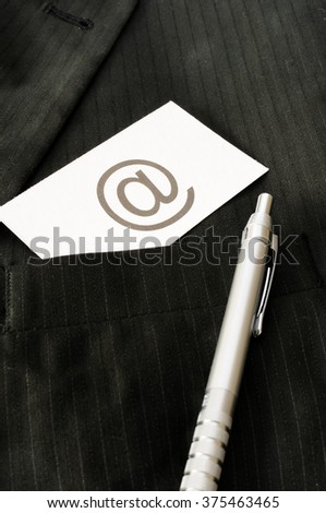 Business card with the sign AT - EMAIL  - stock photo