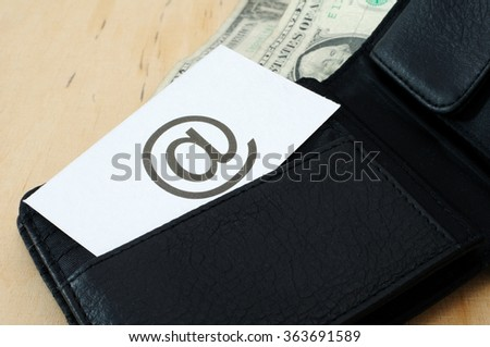 Business card with the sign (at) in wallet with dollars   - stock photo